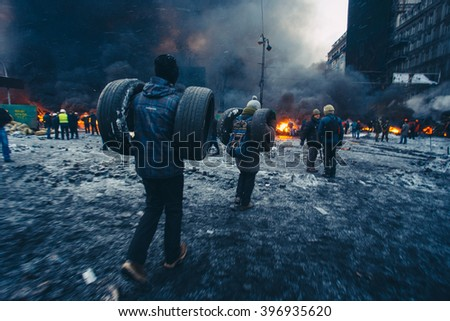 Kyiv, Ukraine - 23 January, 2014: Protesters burn tires to stop the riot police, because Ukrainian police want to storm the main anti-government protest camp in the Kiev - stock photo