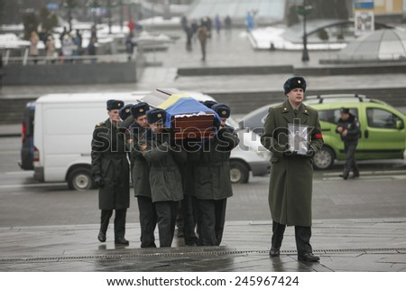 Kyiv, Ukraine - 21 January 2015:  Ukrainian soldiers carry a coffin with Tomaz Sukhiashvili (35), a Georgian serviceman, who was killed in eastern Ukraine conflict, during his funeral ceremony in Kiev
