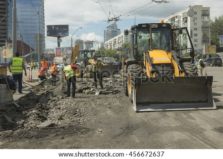 Kyiv, Ukraine Jul 2016: Road Paving, construction. Workers laying stone mastic asphalt during street repairing works 2016 in Kyiv on Peremogy ave - One of the central roads of Kiev