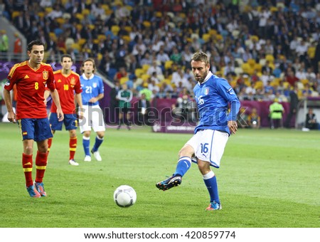 KYIV, UKRAINE - JULY 1, 2012: Daniele De Rossi of Italy (in Blue) kicks the ball during UEFA EURO 2012 Final game against Spain at Olympic stadium in Kyiv, Ukraine - stock photo