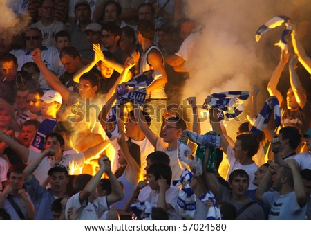 KYIV, UKRAINE - JULY 9: Dynamo Kyiv ultras (ultra supporters) burn a flares during first game of Ukraine Championship season 2010/11 against FC Obolon on July 9, 2010 in Kyiv, Ukraine