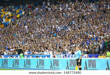 KYIV, UKRAINE - JULY 28: FC Dynamo Kyiv team supporters show their support during Ukraine Championship game against FC Sevastopol on July 28, 2013 in Kyiv, Ukraine - stock photo
