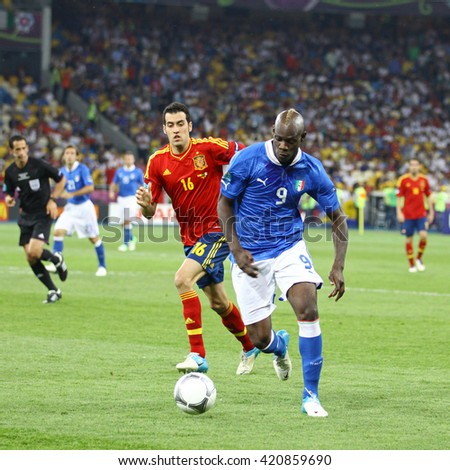 KYIV, UKRAINE - JULY 1, 2012: Mario Balotelli of Italy (in Blue) controls a ball during UEFA EURO 2012 Final game against Spain at Olympic stadium in Kyiv, Ukraine - stock photo
