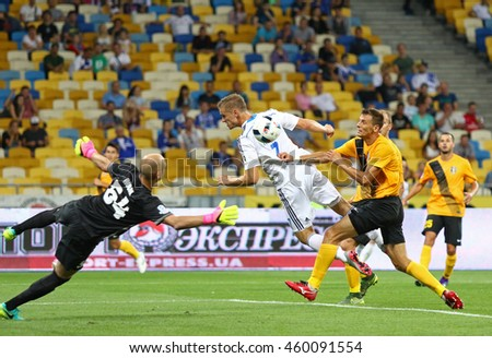 KYIV, UKRAINE - JULY 23, 2016: Oleksandr Gladkyy of FC Dynamo Kyiv (in White) fights for a ball with FC Oleksandria players during Ukrainian Premier League game at NSC Olympic stadium in Kyiv