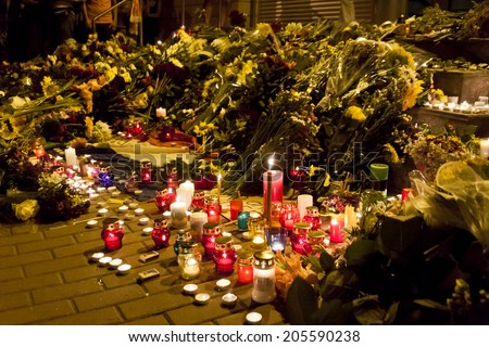 KYIV, UKRAINE - JULY 17, 2014: People place flowers at Dutch embassy in Kyiv after Malaysia Airlines Boeing 777 originating in Amsterdam crashed in Eastern Ukraine