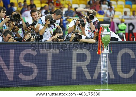 KYIV, UKRAINE - JULY 1, 2012: Photographers take pictures of UEFA EURO 2012 Football Trophy (Cup) during final game between Spain and Italy at NSC Olympic stadium in Kyiv, Ukraine - stock photo