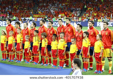 KYIV, UKRAINE - JULY 1, 2012: Players of Spain football team sing the national anthen before UEFA EURO 2012 Final game against Italy at Olympic stadium in Kyiv, Ukraine - stock photo