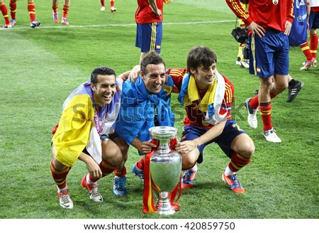 KYIV, UKRAINE - JULY 1, 2012: Players of Spain national football team celebrates their winning of the UEFA EURO 2012 Championship after the final game against Italy at NSC Olympic stadium in Kyiv - stock photo