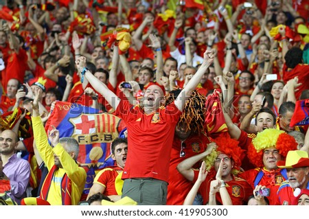 KYIV, UKRAINE - JULY 1, 2012: Spain national football team supporters show their support during UEFA EURO 2012 Championship final game at NSC Olympic stadium in Kyiv, Ukraine - stock photo