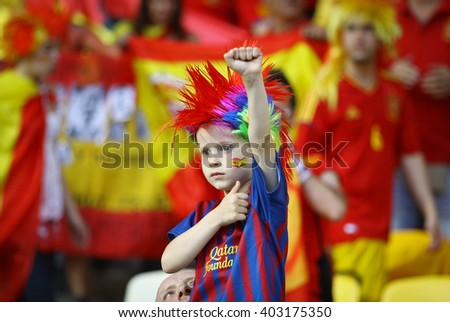 KYIV, UKRAINE - JULY 1, 2012: Spain national football team young supporter shows his support during UEFA EURO 2012 Championship final game at NSC Olympic stadium in Kyiv, Ukraine - stock photo