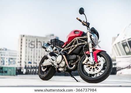 Kyiv, Ukraine - July 7th, 2015: Red motorcycle Ducati Monster at the city street. - stock photo
