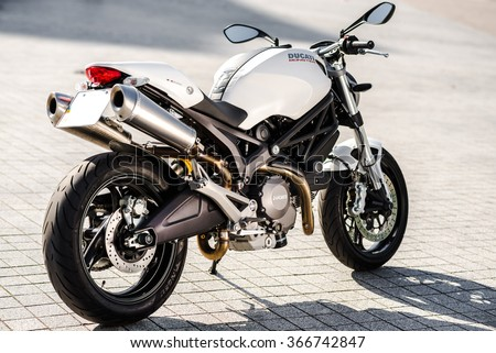 Kyiv, Ukraine - July 7th, 2015: White motorcycle Ducati Monster at the city street.