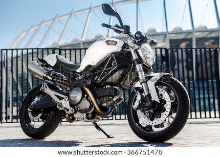Kyiv, Ukraine - July 7th, 2015: White motorcycle Ducati Monster at the city street. - stock photo