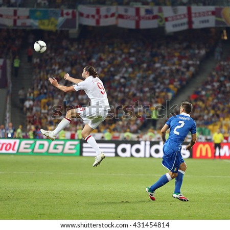 KYIV, UKRAINE - JUNE 24, 2012: Andy Carroll of England (L) fights for a ball with Christian Maggio of Italy during their UEFA EURO 2012 Quarter-final game at Olympic stadium in Kyiv, Ukraine