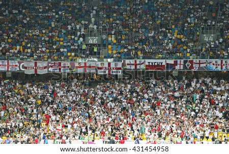 KYIV, UKRAINE - JUNE 24, 2012: England football supporters show their support during UEFA EURO 2012 Quarter-final game against Italy at NSC Olympic stadium in Kyiv