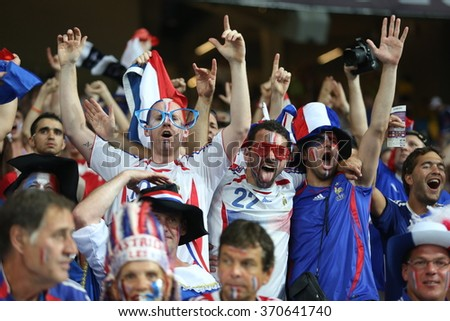 KYIV, UKRAINE - JUNE 19: France national football team supporters show their support  before UEFA EURO 2012 game against Sweden on Olympic stadium (NSC Olimpiysky) on June 19, 2012 in Kyiv, Ukraine. - stock photo