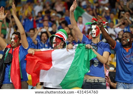 KYIV, UKRAINE - JUNE 24, 2012: Italian football supporters show their support during UEFA EURO 2012 Quarter-final game against England at NSC Olympic stadium in Kyiv - stock photo