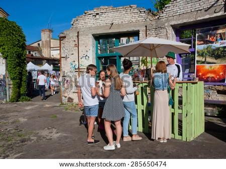 KYIV, UKRAINE - JUNE 6, 2015: Students drinking at the chip outdoor bar during the Kiev Food & Wine Festival on June 20, 2014. Ukrainian capital, Kiev has population near 2,900,200  - stock photo