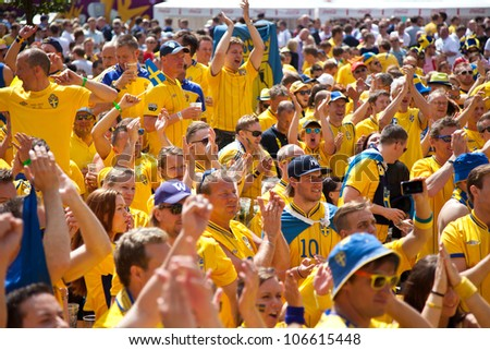 KYIV, UKRAINE - JUNE 15: Sweden and Ukrainian fans arrive in the fanzone before match Euro 2012 between England - Sweden on June 15, 2012 in Kyiv, Ukraine. Zone for the fans UEFA EURO Championship. - stock photo