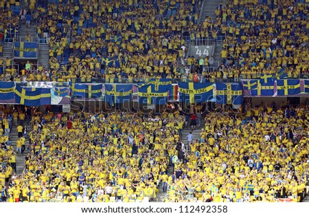 KYIV, UKRAINE - JUNE 15: Sweden fans at NSC Olympic stadium during their UEFA EURO 2012 game against England on June 15, 2012 in Kyiv, Ukraine - stock photo