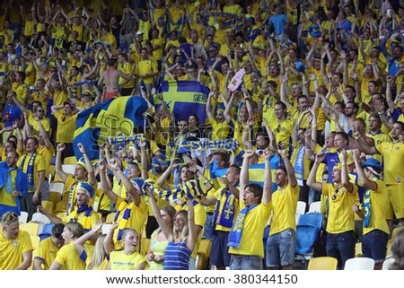 KYIV, UKRAINE - JUNE 11, 2012: Swedish football supporters show their support during UEFA EURO 2012 game against Ukraine at Olympic stadium in Kyiv - stock photo