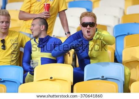 KYIV, UKRAINE - JUNE 19: Swedish national football team supporters show their support  before UEFA EURO 2012 game against Sweden on Olympic stadium (NSC Olimpiysky) on June 19, 2012 in Kyiv, Ukraine. - stock photo