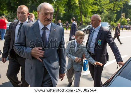 KYIV, UKRAINE - 08 JUNE 2014: The President of Belarus Alexander Lukashenko with youngest son visit the inauguration of Ukrainian President Petro Poroshenko. June 08, 2014 in Kyiv, Ukraine - stock photo