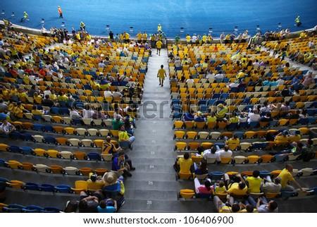 KYIV, UKRAINE - JUNE 11: Tribunes of Olympic stadium (NSC Olimpiysky) during UEFA EURO 2012 game between Ukraine and Sweden on June 11, 2012 in Kyiv, Ukraine - stock photo