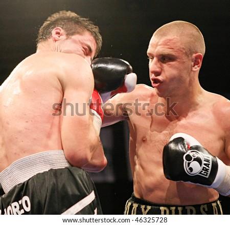 KYIV, UKRAINE - JUNE 14: Ukrainian Maxim Bursak (R) fights with his Italian opponent Giovanni de Carolisa during the boxing tournament on June 14, 2008 in Kyiv, Ukraine - stock photo