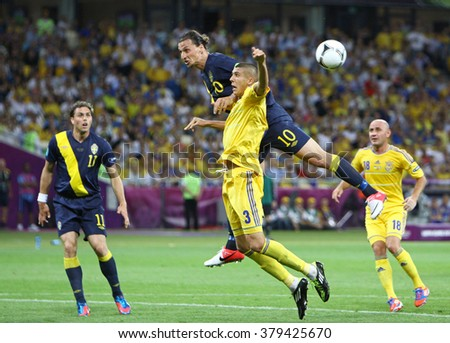 KYIV, UKRAINE - JUNE 11, 2012: Zlatan Ibrahimovic of Sweden (#10) fights for a ball with Yevhen Khacheridi of Ukraine during their UEFA EURO 2012 game at Olympic stadium in Kyiv - stock photo