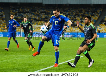 KYIV, UKRAINE - MAR 28: Artem Fedetskyi (17) and Neil Taylor (3) during the friendly match national team of Ukraine vs Wales, 28 March 2016, Olympic Stadium, Kyiv, Ukraine