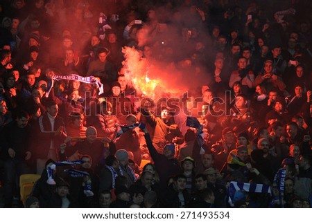 KYIV, UKRAINE - MARCH 19, 2015: FC Dynamo Kyiv team supporters show their support during their UEFA Europa League game against FC Everton at Olympic stadium in Kyiv - stock photo