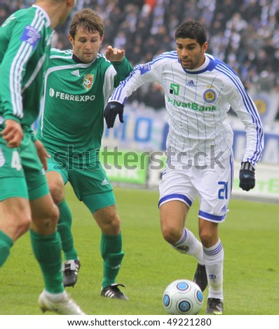 KYIV, UKRAINE - MARCH 13: Gerson Magrao of Dynamo Kyiv (R) controls a ball during Ukraine Championship game against Vorskla Poltava on March 13, 2010 in Kyiv, Ukraine