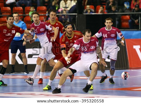 KYIV, UKRAINE - MARCH 19, 2016: HC Motor (in white) and MVM Veszprem handball players fight for a ball during their 2015/16 VELUX EHF Champions League Last 16 Handball game at Ice Terminal Brovary - stock photo