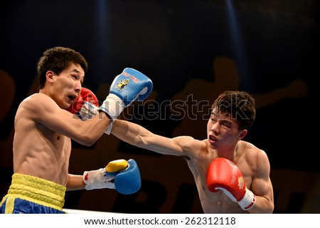 Kyiv, UKRAINE - March 20, 2015 : Hu Jianguan (China)  and VUSENALIEV Azat (UA) in the ring during boxing fight Ukraine Otamans vs China Dragons in Palace of Sport in Kiev, Ukraine
