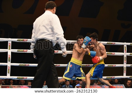 Kyiv, UKRAINE - March 20, 2014 : Hu Jianguan (UK)  and VUSENALIEV Azat (UA) in the ring during boxing fight Ukraine Otamans vs China Dragons in Palace of SPport in Kiev, Ukraine