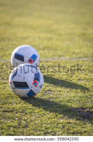 KYIV, UKRAINE - MARCH 28, 2016: Official match balls of the UEFA EURO 2016 Tournament (Adidas Beau Jeu) on the grass during the Open training session of Ukraine National Football Team - stock photo
