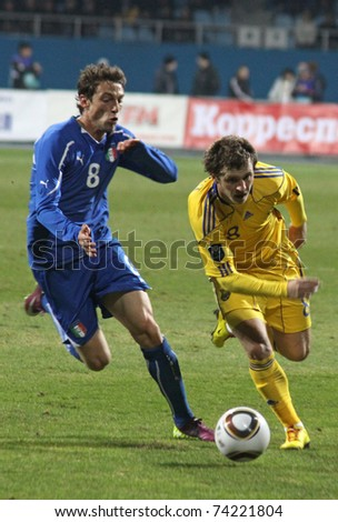 KYIV, UKRAINE - MARCH 29: Oleksandr Aliev of Ukraine (R) fights for a ball with Claudio Marchisio of Italy during their friendly match on March 29, 2011 in Kyiv, Ukraine