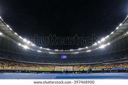 KYIV, UKRAINE - MARCH 28, 2016: Panoramic view of NSC Olympic stadium before Friendly match between Ukraine and Wales, Kyiv, Ukraine - stock photo