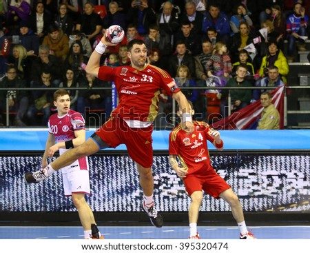 KYIV, UKRAINE - MARCH 19, 2016: Renato Sulic of MVM Veszprem attacks during the 2015/16 VELUX EHF Champions League Last 16 Handball game against HC Motor at Ice Terminal Brovary in Kyiv, Ukraine - stock photo