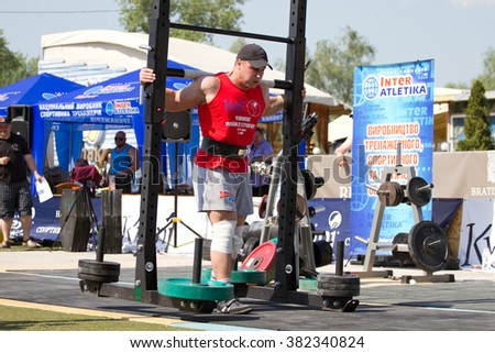 KYIV, UKRAINE - MAY 23, 2015: Championship of Ukraine strongmen, athletes compete in lifting heavy barbell in Kiev, Ukraine - stock photo