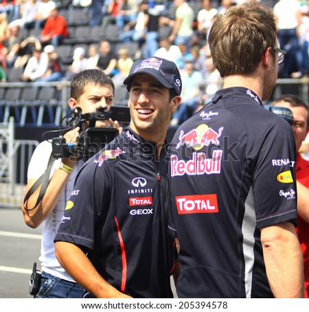 KYIV, UKRAINE - MAY 19, 2012: Driver Daniel Ricciardo of Red Bull Racing Team looks on during Red Bull Champions Parade on the streets of Kyiv city - stock photo