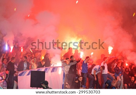 KYIV, UKRAINE - MAY 14, 2015: FC Dnipro ultras (ultra supporters) burn flares during UEFA Europa League semifinal game against Napoli at NSK Olimpiyskyi stadium in Kyiv