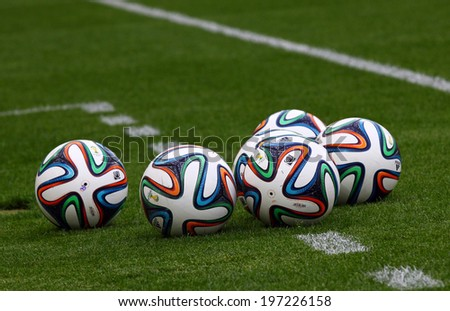 KYIV, UKRAINE - MAY 18, 2014: Official FIFA 2014 World Cup balls (Brazuca) on the grass during Ukraine Championship game between FC Dynamo Kyiv and FC Zorya Luhansk at Olympic stadium in Kyiv - stock photo