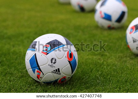 KYIV, UKRAINE - MAY 20, 2016: Official match balls of the UEFA EURO 2016 Tournament (Adidas Beau Jeu) on the grass during the Open training session of Ukraine National Football Team in Kyiv, Ukraine