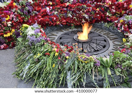 KYIV, UKRAINE - MAY 09, 2015: The seventieth anniversary of the terminal of the Second World War. Flowers on Monument  with Eternal fire to the unknown soldier