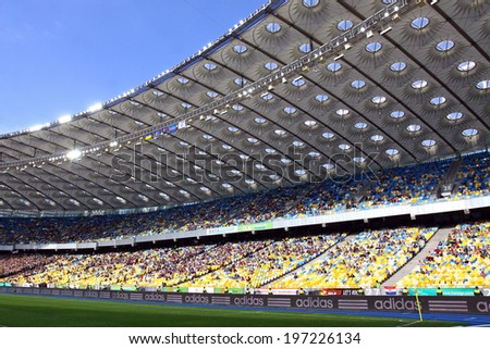 KYIV, UKRAINE - MAY 18, 2014: Tribunes of Olympic stadium (NSC Olimpiyskyi) during Ukraine Championship game between FC Dynamo Kyiv and FC Zorya Luhansk - stock photo