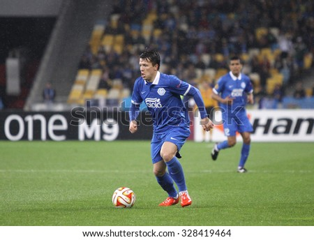 KYIV, UKRAINE - MAY 14, 2015: Yevhen Konoplyanka of FC Dnipro controls a ball during UEFA Europa League semifinal game against SSC Napoli at NSK Olimpiyskyi stadium in Kyiv  - stock photo