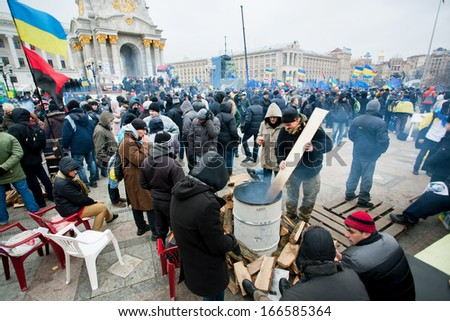 KYIV, UKRAINE - NOV 28: People kindle fire on the cold occupying Maidan square during two weeks anti-government protest on November 28, 2013, in Kiev, Ukraine. - stock photo
