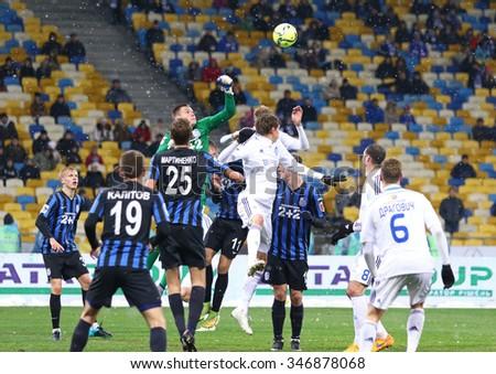 KYIV, UKRAINE - NOVEMBER 29, 2015: FC Dynamo Kyiv (in White) and FC Chornomorets Odesa players fight for a ball during their Ukrainian Premier League game at NSC Olimpiyskyi stadium - stock photo